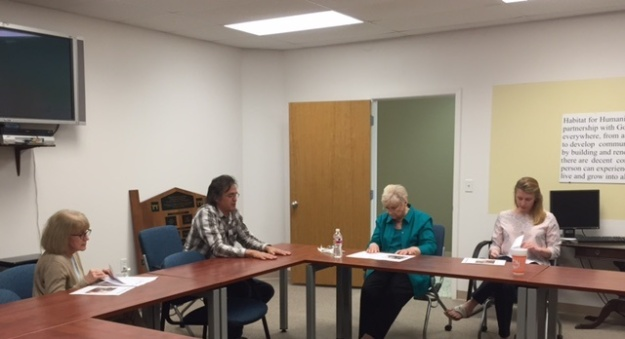 Women's Fund representatives Patty Machin, Dr. Mary Fischer and Ellen Krafve discuss repairs on Winnie Williams' home with Raimund Gideon, Smith County Habitat's Director of Construction.