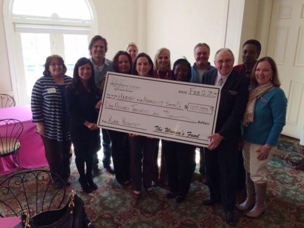 Members of Smith County Habitat's Staff and Board celebrate receiving The Women's Fund grant.