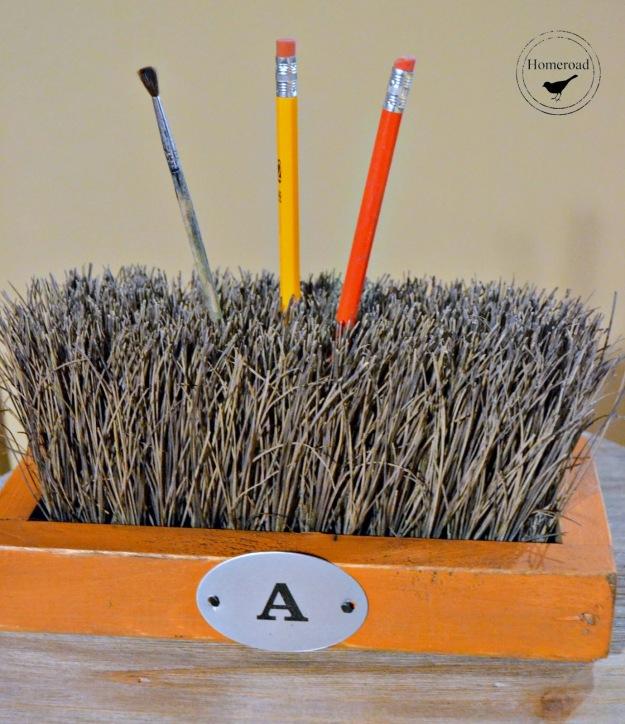 push-broom-organizer-orange