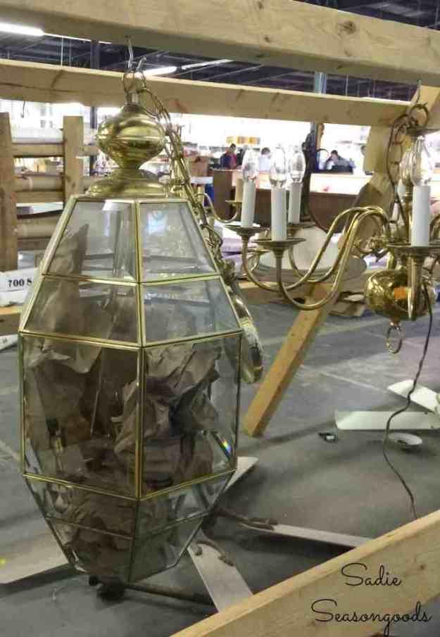 Outdated_brass_chandelier_at_Habitat_ReStore_to_be_repurposed_by_Sadie_Seasongoods.jpg