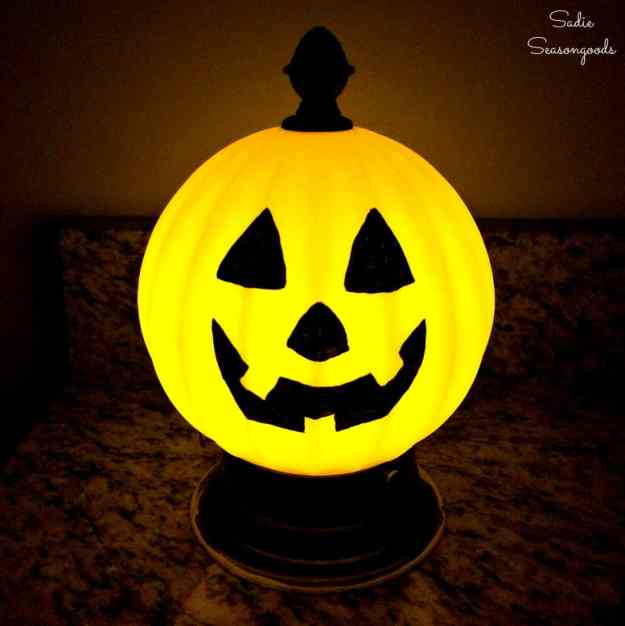 Repurposed_and_upcycled_vintage_light_fixture_globe_into_DIY_jack_o_lantern_pumpkin_for_Halloween_decor_by_Sadie_Seasongoods.jpg